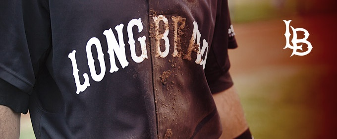 Player wearing a mud-caked Long Beach Dirtbags Jersey