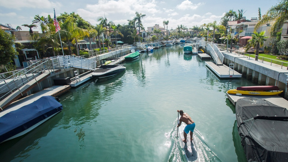 Paddleboarder heads down canal