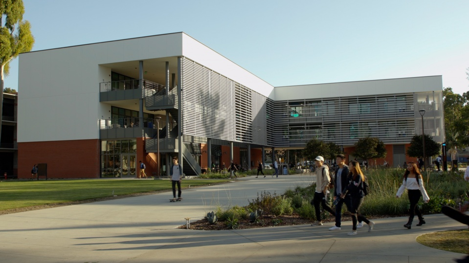 Students walk past the new CCPE building.