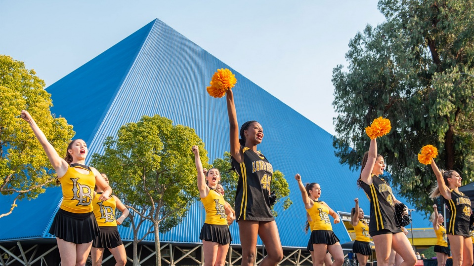 cheerleaders in front of pyramid