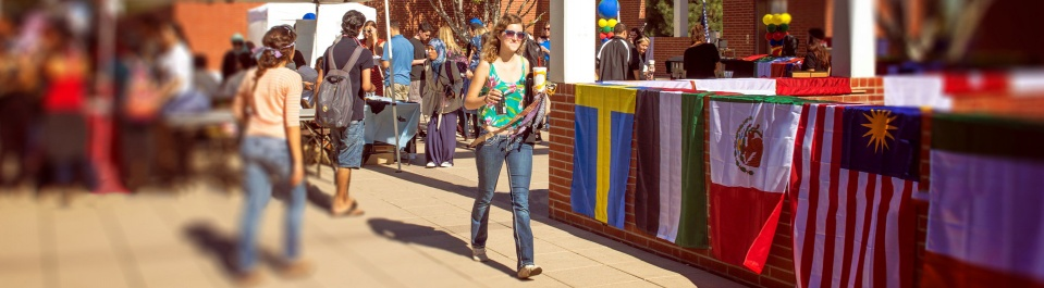 A student walks through campus during an international faire