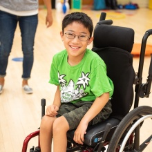 Child in wheelchair at Camp Nugget