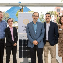 officials at solar panel unveiling