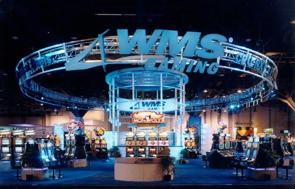 The interior of a building that has a large WMS Gaming logo at the top.