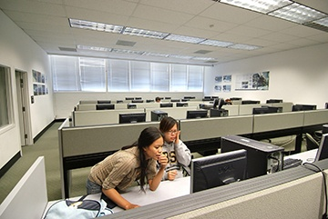 two students collaborating in computer lab