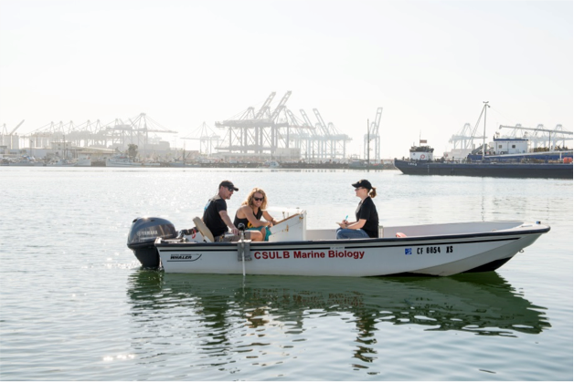 Fig. 18. Chris Lowe, Mike Farris, and Bonnie Ahr in a boat in a harbor