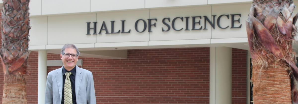 Dean Curtis Bennett in front of Hall of Science