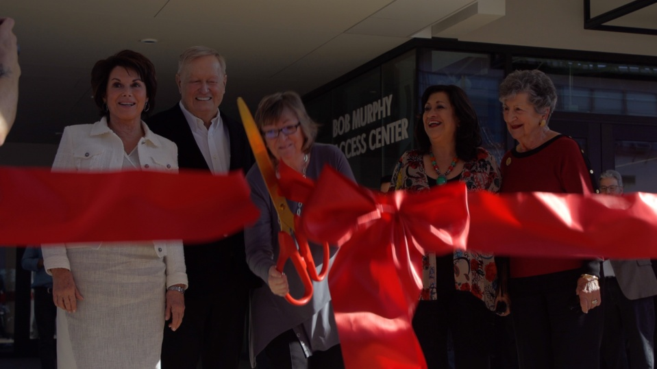Jane Close Conoley cuts the ceremonial ribbon on the new Student Success Center.