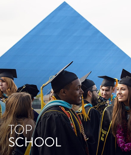 Students in front of Pyramid at graduation